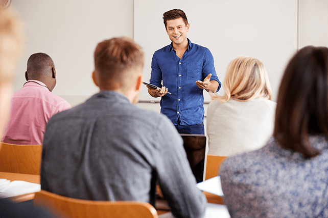 male TEFL teacher leading business English lesson