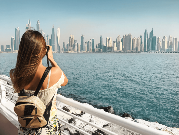 Girl in UAE by the water - Best Places to Teach English Abroad 2020