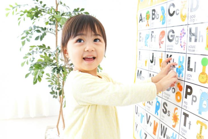 Little girl learning English in an ESL classroom.