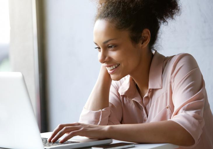 Woman looking up how to find students for online teaching.