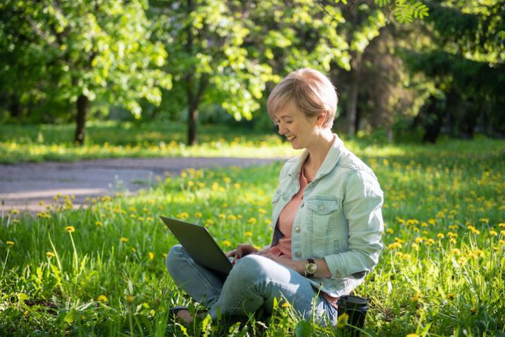 woman teaching English on laptop outside: how to make teaching english interesting.