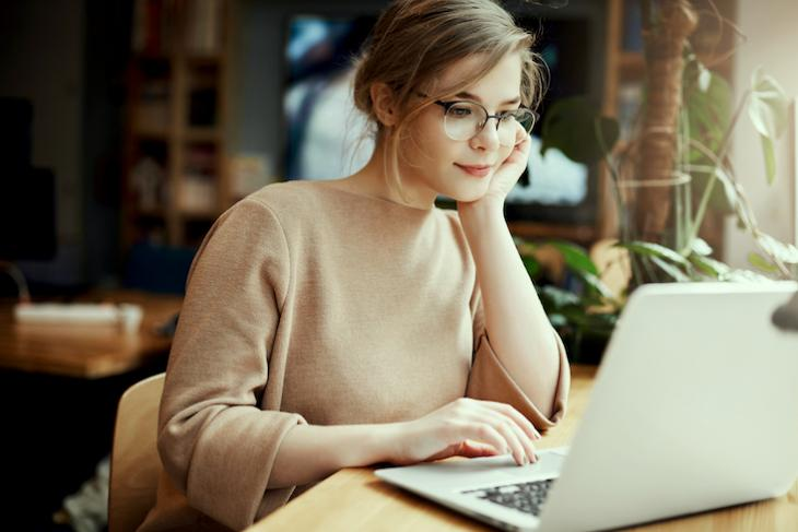 woman applying for jobs online - how to teach in a different country