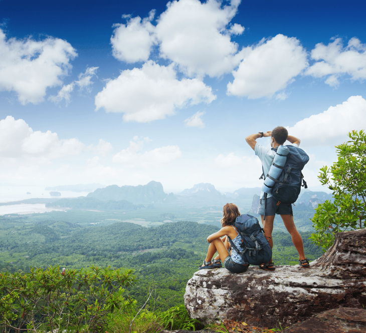 couple hiking a mountain - how to travel the world and make money
