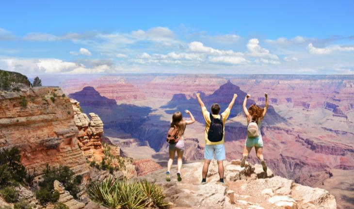 family admiring the view of the grand canyon