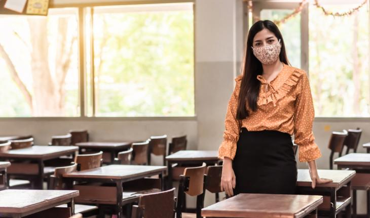 woman teacher wearing a mask in a classroom