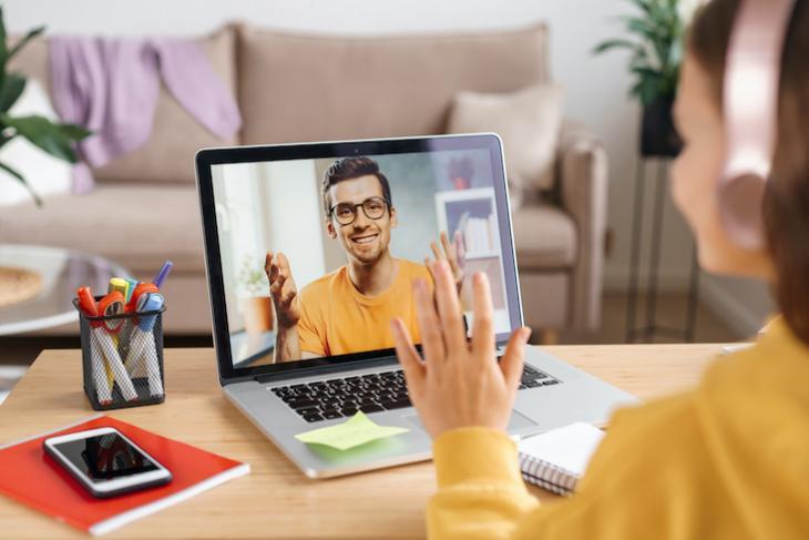 Photo of man teaching kids English online.