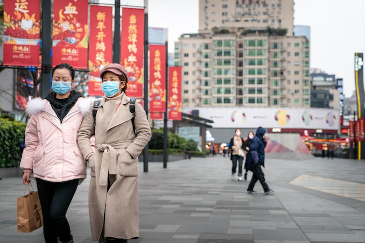 Photo of women walking the streets of China.