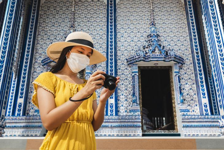 Photo of woman traveling in Thailand during covid.