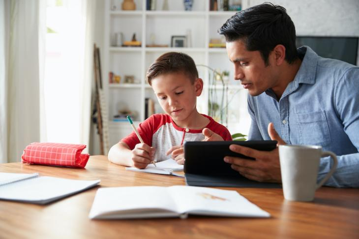 father teaching child at home - will online learning replace classroom teaching?